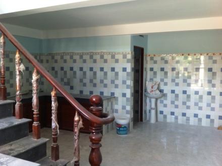 bếp nấu nhà mới xây ở dĩ an, nhà có 3 phòng trọ phía sau
