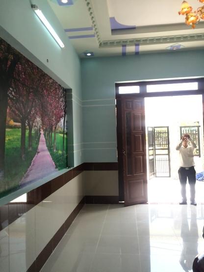 trang trí tường nhà mới gần trung tâm hành chính dĩ an