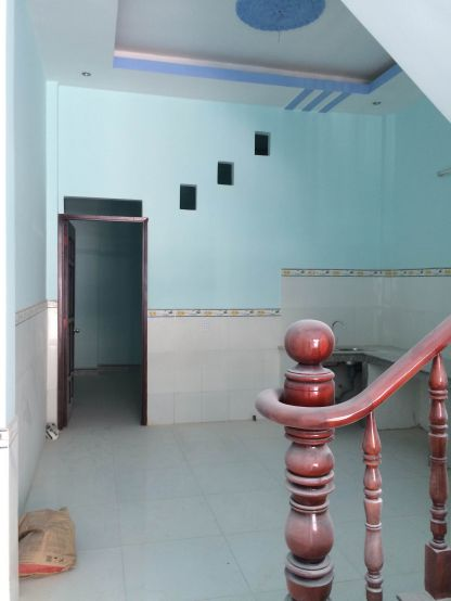 Không gian sau bếp nấu + ăn + tolet + phòng ngủ.