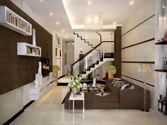 Mẫu phòng khách nhà ống đẹp trung tâm nhà có cầu thang rất phù hợp.